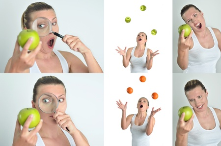 Healthy blondy happy woman looks green apple with magnifying glass photo