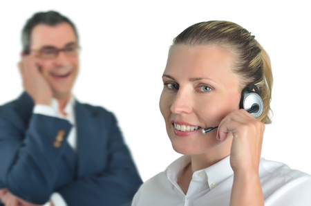 Beautiful business woman with headset and talking to a businessman Stock Photo - 13232208