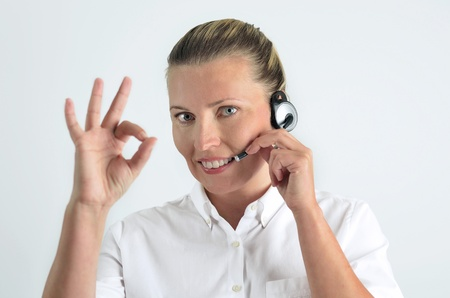 Blondy beautiful girl with headphone in call center photo