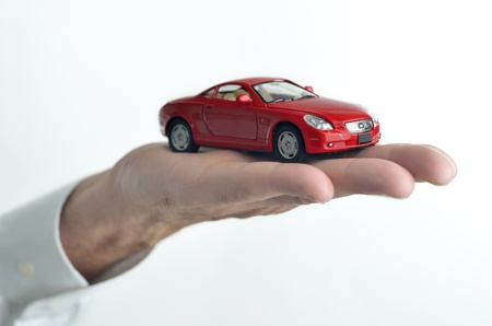 Man holding a toy car on his hand photo