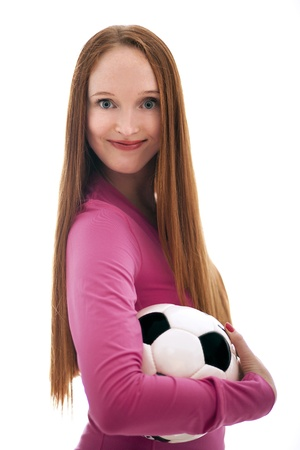 Beautiful long haired girl holding a soccer ball isolated on the white background photo