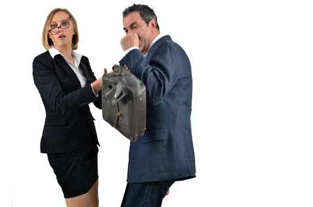 Angry businesswoman is hitting across the businessman photo