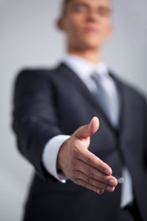 A business man with an open hand ready to seal a deal Stock Photo - 14411406