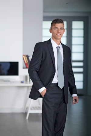 Portrait of a successful young Businessman posing in office photo