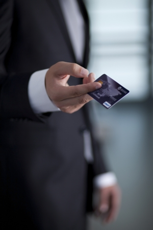 Businessman holding an credit card photo