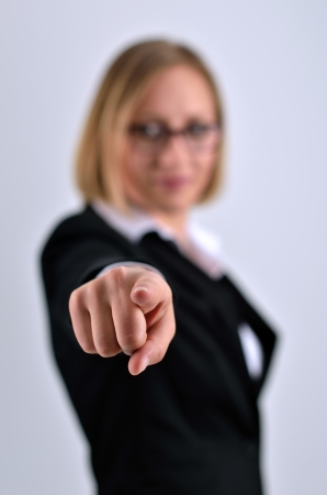 Young beautiful businesswoman aiming by her hand  photo