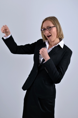 Business woman getting into a fight photo