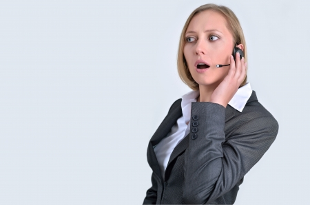 Young beautiful girl with headphone in call center photo