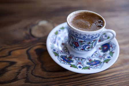 A cup of Turkish coffee on wooden table photo