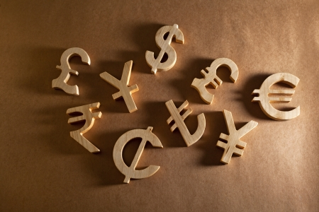 Wooden economy and currency unit on a craft background photo