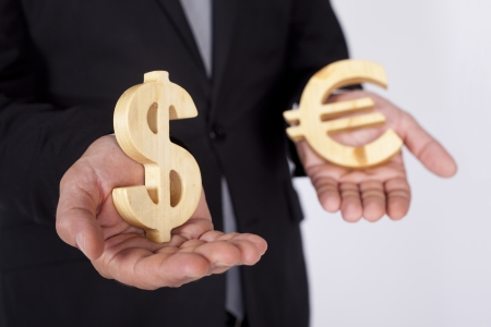Businessman is holding Dollar and Euro icons photo