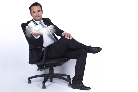 Businessman sitting on a chair and presents cloud technology photo