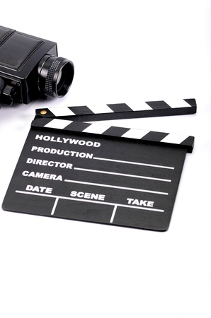 Old camera and movie clapper board, isolated , movie industry concept Stock Photo - 16995402