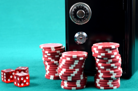 hold em: Poker gambling chips, Stacks of poker chips and the metal safe with lock