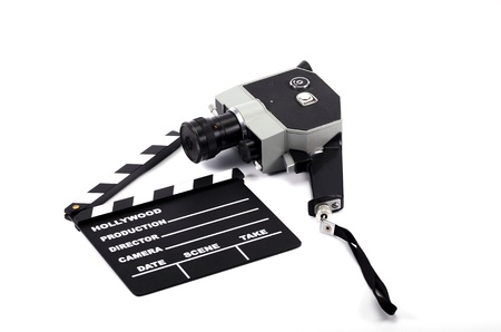 Old camera and movie clapper board, isolated , movie industry concept Stock Photo - 16995425