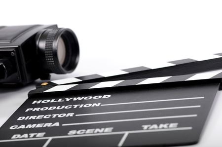 Old camera and movie clapper board, isolated , movie industry concept Stock Photo - 16995500