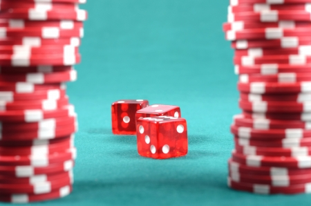 poker gambling chips on a green playing table, stacks of poker chips , casino concept Stock Photo