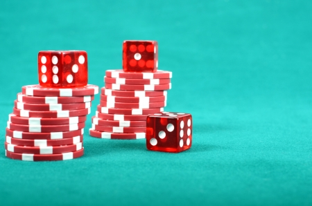 gambling chip: Poker gambling chips on a green playing table, stacks of poker chips , casino concept Stock Photo