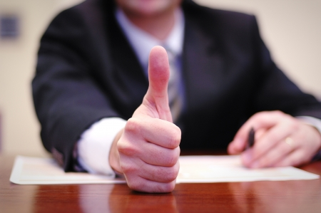 Businessman showing thumbs up