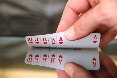 Gambling concept, human hand showing playing cards on the glass table