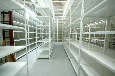 Empty warehouse racks, Empty metal shelf in storage room, storage concept Stock Photo - 17228605