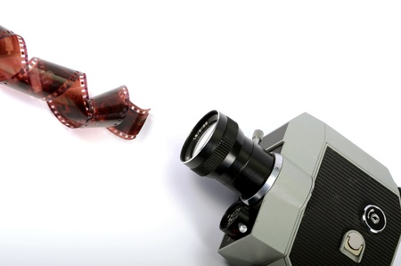 Old camera and film strip isolated Stock Photo - 17301304