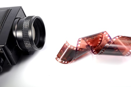 Old camera and film strip Stock Photo - 17300458