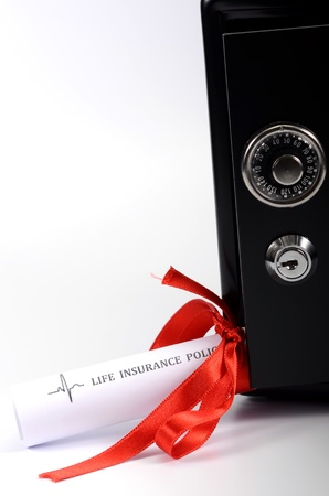 Life insurance policy and steel safe Stock Photo - 17300459