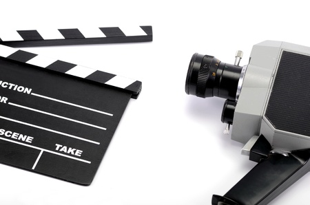 Old camera and movie clapper board, isolated , movie industry concept  photo