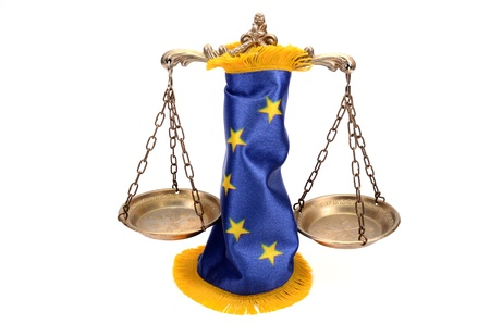 Scales of Justice and European union flag  on the white background, EU law concept Stock Photo