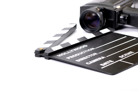 Old camera and movie clapper board, isolated , movie industry concept
