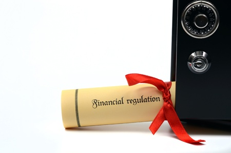 Financial regulation and steel safe on the white backround, Financial regulation concept Stock Photo