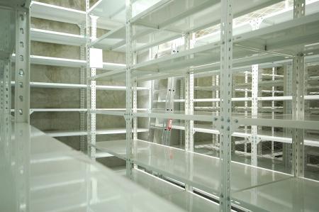 Empty warehouse racks, Empty metal shelf in storage room, storage concept photo