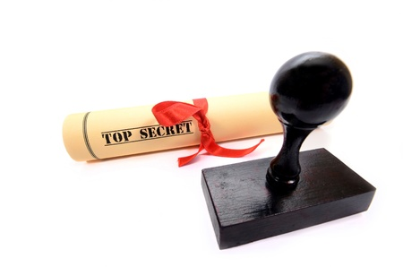 Classified, restricted, top secret document and rubber stamp on the white background