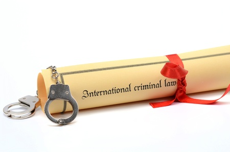 Handcuffs and International criminal law, law concept