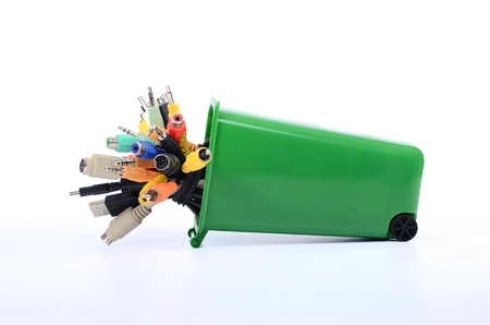 Recycle Bin filled with electronic waste , recycling electronics, recycling e-waste Stock Photo