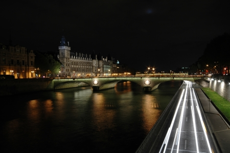 The Pont au Change  over the Seine River in Paris, France photo