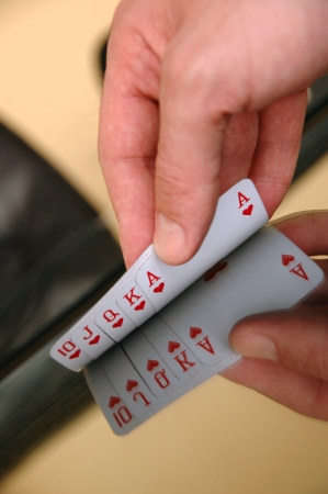 Gambling concept, human hand showing playing cards on the glass table photo