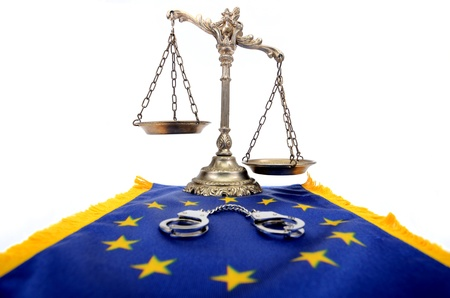 Scales of Justice, European Union flag and handcuffs photo