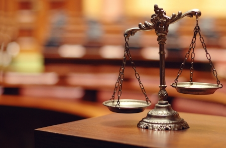 the litigation: Symbol of law and justice in the empty courtroom, law and justice concept. Stock Photo
