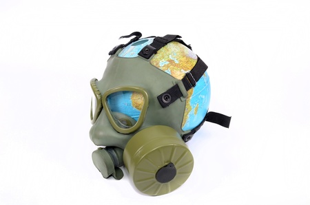 Global Earth and environmental pollution concept, Globe with gas mask isolated Stock Photo