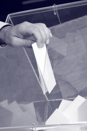 ballot box: Image of a ballot box and hand putting a blank ballot inside,elections, voting concept