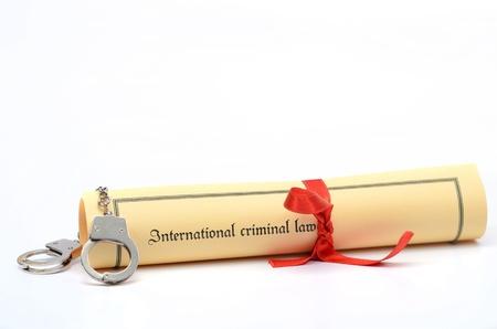 criminal law: Handcuffs and International criminal law