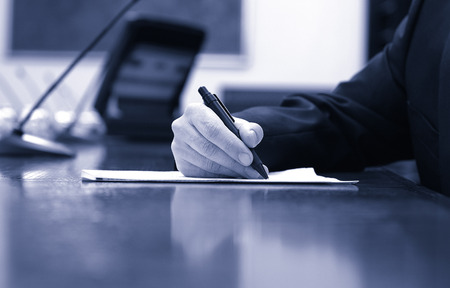 business contract: Businessman working on the contract, business  meeting , contract signing concept, blue toned