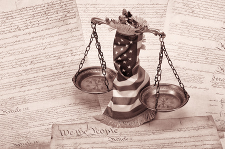 litigate: Scales of justice , American flag and US Constitution