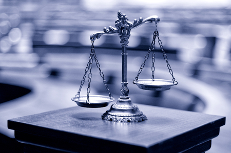 Symbol of law and justice in the empty courtroom, law and justice concept. Archivio Fotografico
