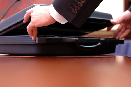 Close up of open briefcase  at the start of the business meeting , business concept