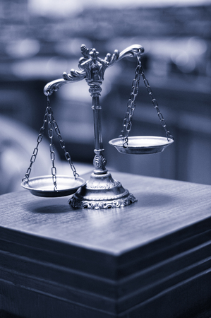 Symbol of law and justice in the empty courtroom, law and justice concept. blue toned Stock Photo