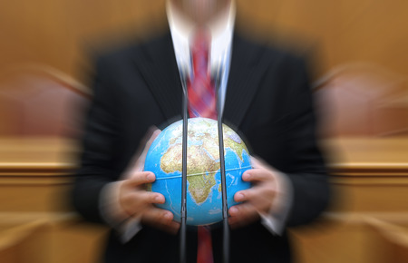 junked: Politician holding the planet Earth , global pollution concept, Radial zoom filter effect applied Stock Photo