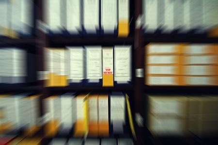 Old archive shelves full of top secret paper documents , old archive concept , top secret concept. Radial zoom filter effect focused on top secret archive unit